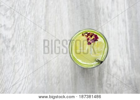 Overhead Of Lime Juice On Wooden Tabletop With Copy Space