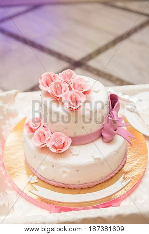 White Wedding Cake On Wedding Banquet With Red Rose And Other Flowers
