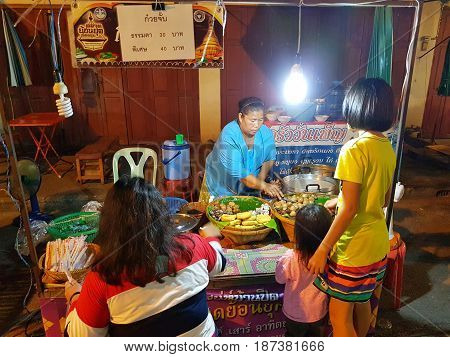 KAMPHAENG PHET THAILAND - MAY 6 : unidentified asian woman with Thai traditional clothing selling Chinese roll noodle soup in Nakhon Chum street market on May 6 2017 in Kamphaeng Phet Thailand.
