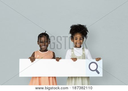 Little girl smiling and holding blank search placard