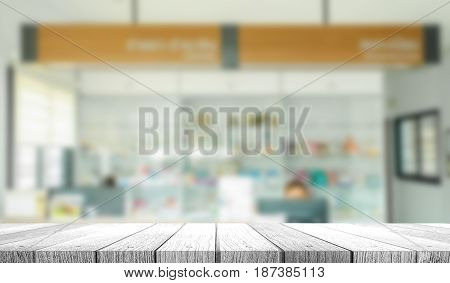 Empty wood counter top on blur hospital counter background