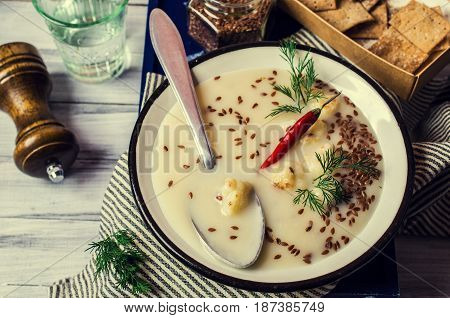 Creamy cauliflower soup with flax seeds. Selective focus.