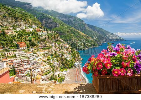 View of the town of Positano from terrace with flowers Amalfi Coast Italy
