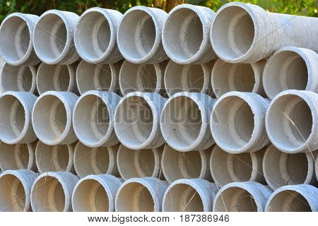 Concrete pipe for house poles in construction shop.