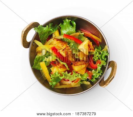 Restaurant vegan dish, tofu stir fry in copper bowl isolated on white, top view. Vegetable mix. Eastern indian local cuisine food.