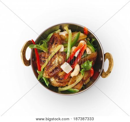 Restaurant vegan dish, fried paneer salad in copper bowl isolated on white. Vegetable mix. Eastern indian local cuisine food.