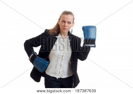 charming young girl in shirt and jacket looks away and wore boxing gloves on hands isolated on white background