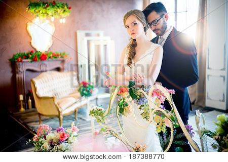 Wedding day concept. A bride and groom in a hotel room.