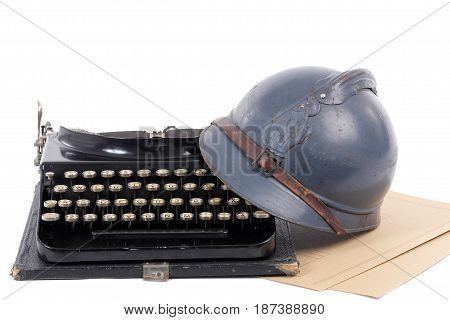 a french military helmet of the First World War with old typewriter