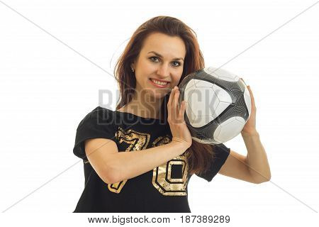 Portrait of a happy beautiful girl athletes who laughs and holds the ball near the face isolated on white background