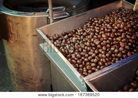 Hot chestnuts in a pan. Chestnuts for sale in the market and festival. selective focus.