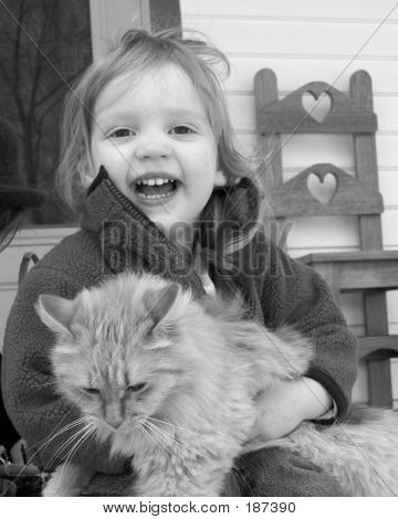 Toddler With A Kitty