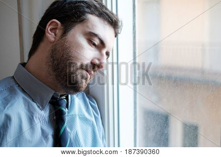Portrait of a restless businessman face close up