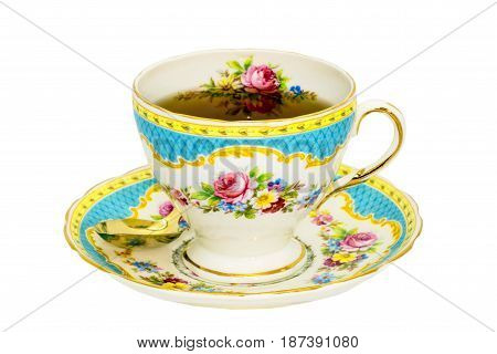 Vintage fine china tea cup and saucer with tea.