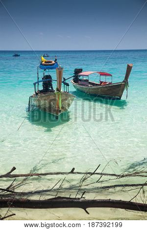 KO PHI PHI, THAILAND, February 2, 2014: Tropical beach with traditional long tail boats on the beach of Bamboo Island, Ko Phi Phi archipelago, Andaman Sea, famous tourist destination in Thailand