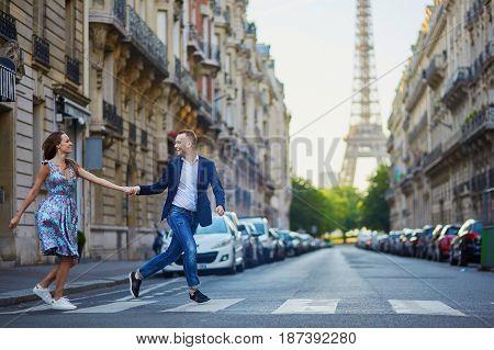 Romantic Couple Near The Eiffel Tower In Paris