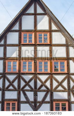 An Old half-timbered house with rustic wooden windows