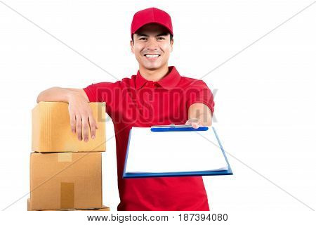 Smiling delivery man giving clipboard for signature