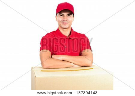 Smiling delivery man with arm crossed over the boxes