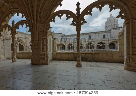 LISBON, PORTUGAL - MAY 11, 2017: People in the cloister of Jeronimos Monastery. Since 1983, the monastery is listed as UNESCO World Heritage site