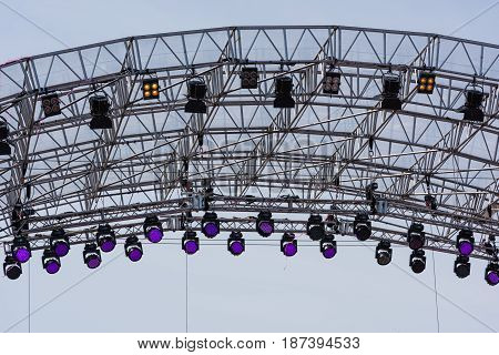Spot lights over the stage. Outdoor shot.