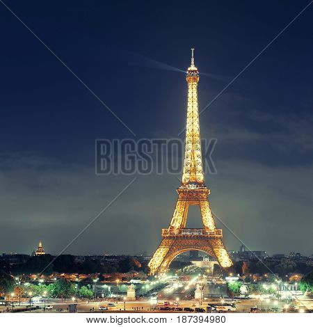 PARIS, FRANCE - MAY 13: Eiffel Tower at night on May 13, 2015 in Paris. It is the most-visited paid monument in the world with annual 250M visitors.