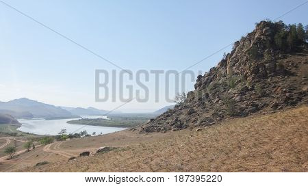 landscape of river in wild rocks with mountains at horizon