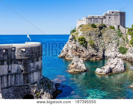 Sea Cove And City Walls Under Fort Lovrijenac In Dubrovnik, Croatia