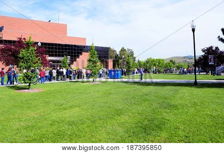 MISSOULA, MONTANA, USA - May 20, 2017: Long line of people waiting for a rally for US House candidate Rob Quist and Senator Bernie Sanders at the University of Montana