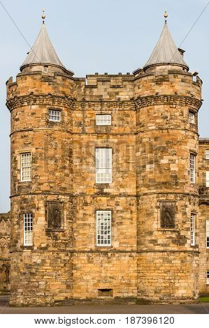 EDINBURGH SCOTLAND - SEPTEMBER 13 2014: detail view of the Palace of Holyroodhouse's left tower in a warm sunset light. This palace is the Queen's official residence in Scotland.