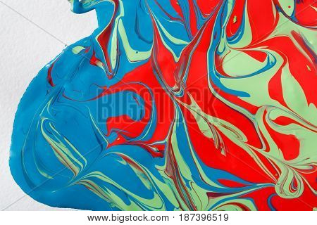 Liquid marbling paint flow on white background. Fluid painting abstract texture. Colorful mix of acrylic vibrant colors.