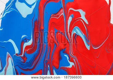 Liquid marbling paint background. Fluid painting bright abstract texture. Colorful mix of acrylic vibrant colors.