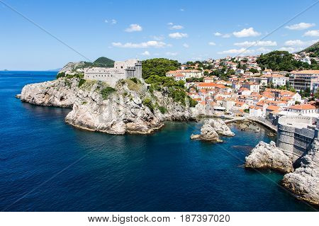DUBROVNIK CROATIA - JULY 19th 2016: sea cove and docks close to Pile Gate walls and Fort Lovrijenac at Old Town. Adriatic's deep blue waters attract many tourists for the sunny summer season.