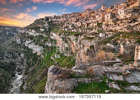 Matera, Basilicata, Italy: landscape at sunrise of the old town (sassi di Matera) with the houses carved into the tufa rock and the creek at the bottom of the deep ravine