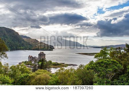 EILEAN DONAN CASTLE DORNIE SCOTLAND - SEPTEMBER 20 2014: HDR panorama of Loch Alsh and Duich under dramatic cloudscape. Tourists visit the historic building when touring Highland and Skye regions.