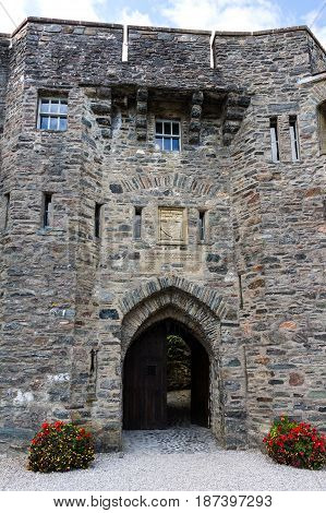 EILEAN DONAN CASTLE DORNIE SCOTLAND - SEPTEMBER 20 2014: access door to the fortress with crest located in the east facade. Tourists visit the historic fortress when touring the Highland and Skye.