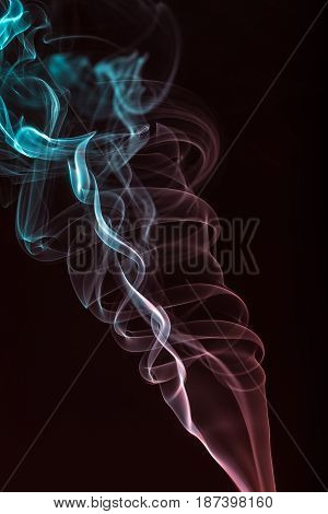 Abstract colored smoke on a black background