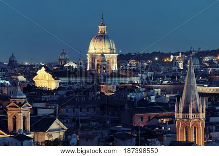 Rome rooftop view with ancient architecture in Italy at night.