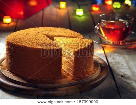 close up view of nice fresh yummy honey cake on  color back