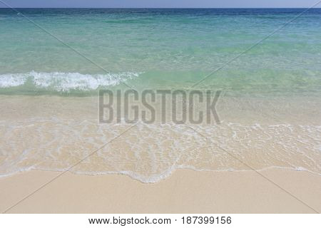 Background picture of white beach wave and summer tropical sea at Koh Samed Island famous tourist attraction in Rayong province Thailand.