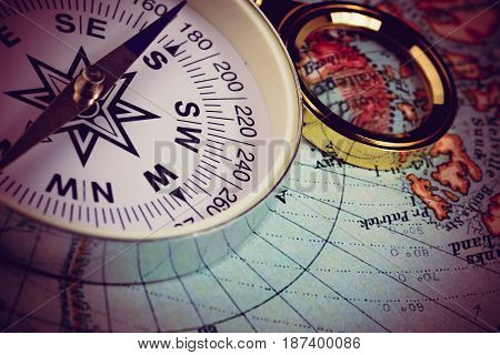 Compass And Magnifying Glass
