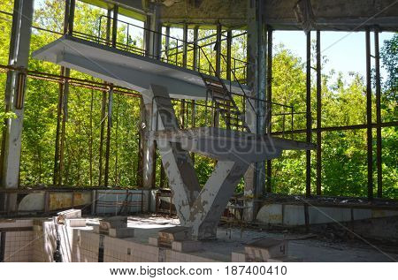 Lost city.Swimming pool in abandoned city Pripyat.Chernobyl Exclusion Zone.May 19, 2017.Kiev region.Ukraine