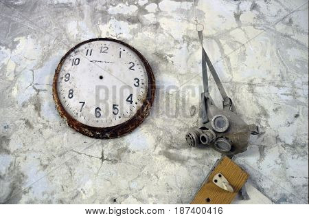 Lost city.Vintage clock.School in abandoned city Pripyat.Chernobyl Exclusion Zone.May 19, 2017.Kiev region.Ukraine