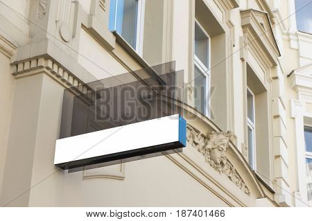 Mock up. Rectangular shape glass signage on the wall of classical architecture building
