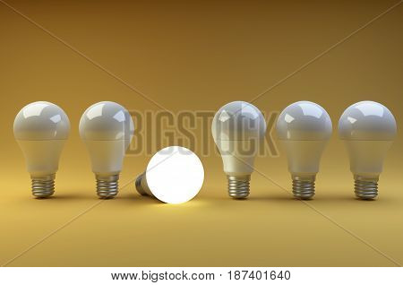 Row of LED light bulbs with one different from the others on a orange background. 3d illustration high resolution