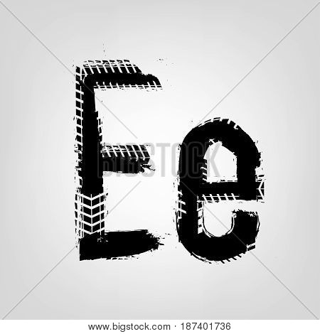 Grunge tire letter E. Unique off road isolated lettering in a black colour. Vector illustration.
