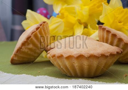 Traditional Easter pastry and yellow daffodil flowers