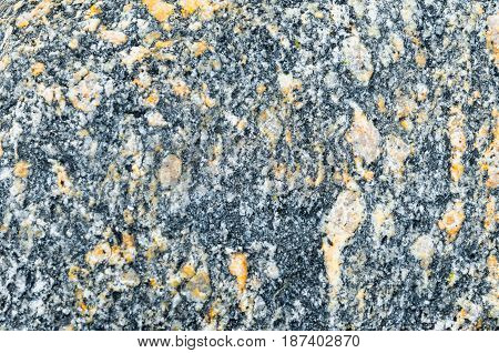 Texture Of Natural Granite, Black With Yellow-orange Impregnation.