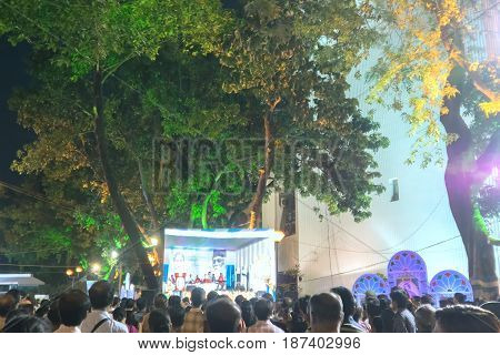 KOLKATA WEST BENGAL INDIA - 9TH MAY 2017 : Delegates seen in a giant screen amongst audience at Rabindra Jayanti celebration (birthday of Late Nobel winner Poet Rabindranath Tagore). Bengalis favourite poet.