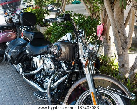 Alghero Italy - May 05 2017: Harley Davidson Heritage Softail Classic parked in the shade